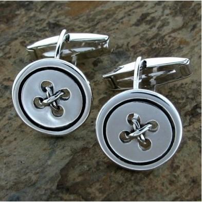 Gemelos de plata con botones