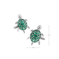 Gemelos con tortuga verde