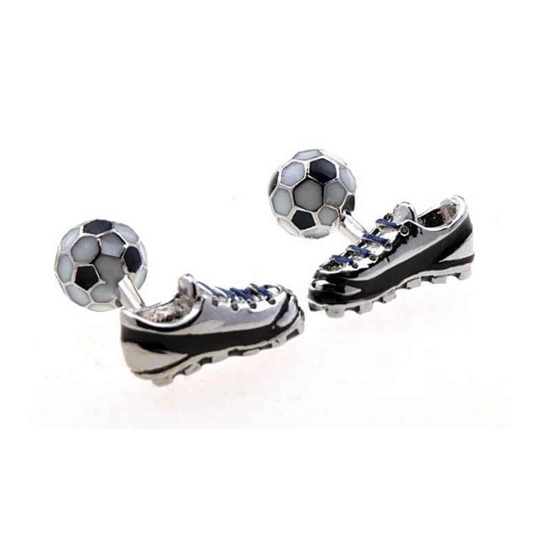 Gemelos con balón y bota de futbol